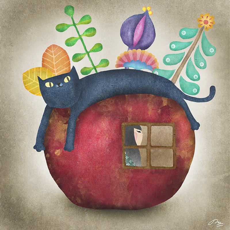 りんごの上にかぶさる猫